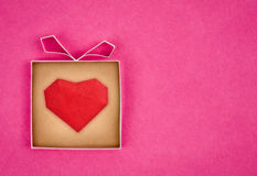 Hand made gift box with heart inside Stock Photos