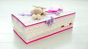 Hand made gift box shoot from the back. With a toy over it Stock Photos