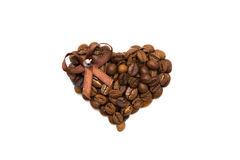 Hand made heart of coffee beans on white. Background Royalty Free Stock Image