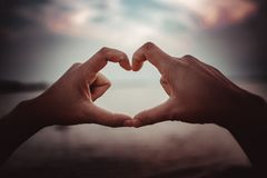 Hand made heart shape in the sky royalty free stock photos