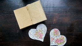Hand made hearts notebook box with dried petals. Hand made hearts notebook and box with dried petals stop motion animation stock video