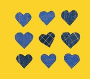 Hand made Jeans hearts on a yellow background. Flat lay, top view, minimal style, copy space for text. Symbol of love. For Valentine`s day greeting card or stock photo