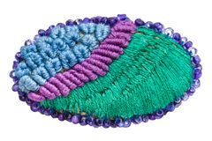 Hand made knitted brooch isolated on white. Background Royalty Free Stock Photos