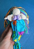 Hand-made Mermaid doll on blue background Royalty Free Stock Photo
