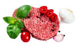 Hand Made From Minced Beef, Pork burgers patties with Basil, garlic, pepper, tomato and sliced red pepper. isolated on white backg Royalty Free Stock Photo