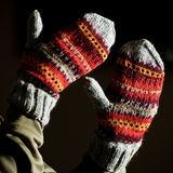 Hand made mittens. On black Royalty Free Stock Photo