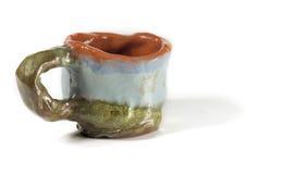 Hand made mug. Hand made blue and green clay mug royalty free stock image