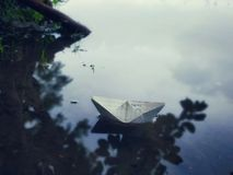 Nature paper boat in lake art craft hand made royalty free stock image