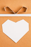 Hand made paper heart on kraft paper as background. Stock Photography