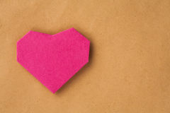 Hand made paper heart on kraft paper as background. Royalty Free Stock Images