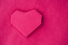 Hand made paper heart on kraft paper as background. Stock Photo