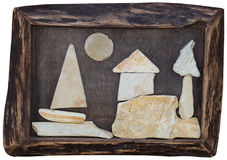 Hand-made picture with stones in wooden frame Royalty Free Stock Images