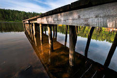 Hand made pier on lake close up Stock Photography