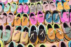 Hand made pink shoes on thai market. Shoes in a marketplace on Koh Samui, Thailand Royalty Free Stock Photo