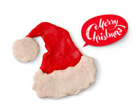 Hand made plasticine figure of Santa hat. With shadow and red lettering banner on white background Royalty Free Stock Photo