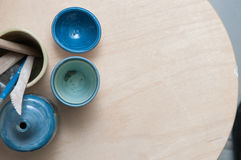 Hand made pottery products displaye on a wooden table Stock Photography