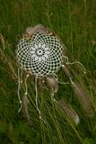 Handmade do-it-yourself Dreamcatcher in the grass stock photo