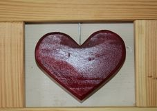 Hand made red heart and wooden frame Stock Photography