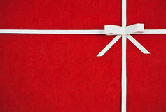 Hand made ribbon and bow on red  paper Stock Photos