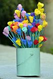 arrangement of handmade colored roses in tin pot royalty free stock image