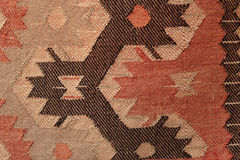 Hand made rug. Traditional woolen hand made rug. Hand made rug. Colorful surface, texture of traditional woolen and vintage hand made rug - close up Stock Photography
