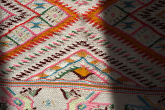Hand made rug. Traditional woolen hand made rug. Hand made rug. Colorful surface, texture of traditional woolen and vintage hand made rug - close up Royalty Free Stock Photo