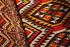 Hand made rug. Traditional woolen hand made rug. Hand made rug. Colorful surface, texture of traditional woolen and vintage hand made rug - close up Royalty Free Stock Photography