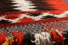 Hand made rug. Traditional woolen hand made rug. Hand made rug. Colorful surface, texture of traditional woolen and vintage hand made rug - close up Stock Image