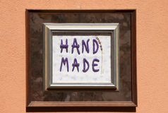 Hand made sign. On building facade Royalty Free Stock Photo