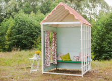 Hand made small wooden house. Wedding decoration. Decorative house for a photo shoot the newlyweds Stock Photo