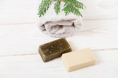 Hand made soap with pine branch and towel.wooden background.top. View Stock Images