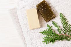 Hand made soap,pine branch and towel.wooden background.top view.  Stock Photo