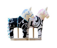 Hand made soft toy horse couple isolated on the stands Stock Images