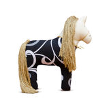 Hand made soft toy horse  with golden mane and bridle Stock Photos