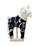 Hand made soft toy horse isolated on black with bl Royalty Free Stock Image