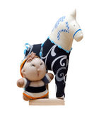 Hand made soft toy horse isolated on black with blue on the stan Royalty Free Stock Photography