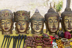 Hand made souvenirs on the market in Inle Lake. Myanmar. Hand-made souvenirs on the counter of the market. Inle Lake. Myanmar . Wooden Buddha mask. Close up Royalty Free Stock Photos