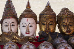 Hand made souvenirs on the market in Inle Lake. Myanmar. Hand-made souvenirs on the counter of the market. Inle Lake. Myanmar . Wooden Buddha mask. Close up royalty free stock image