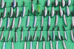 Hand-made spoon baits, tackles and wobblers. Fishing lures and accessories stock photos