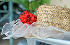 Hand-made straw hat decorated with red flowers Royalty Free Stock Photo