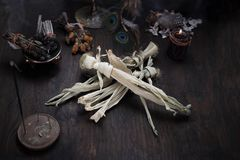 Spells and spells using a voodoo doll stock photos