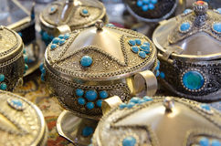 Hand made sugar bowls. Iranian handcraft made of steel and turquoise Stock Image