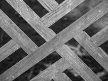 Woden screen made from teak wood showing cross pattern Stock Image