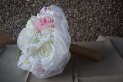 A hand made and tied posy is a fairly tightly formed bouquet, perfect for a bride who likes simple clean lines with minimal fuss. Wedding flowers for the bride royalty free stock images