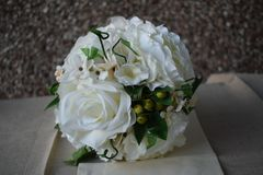 A hand made and tied posy is a fairly tightly formed bouquet, perfect for a bride who likes simple clean lines with minimal fuss. Wedding flowers for the bride stock photo