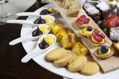 Tray of assorted pastries. Hand made typical italian pastries with cream, chocolate, strawberries, biscuits everithing handmaden Stock Photos