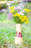 Hand made vase with forest flowers Stock Photo