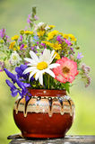 Hand made vase with forest flowers Royalty Free Stock Image