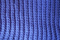 Handmade violet knitted textile with vertical ribbing pattern Royalty Free Stock Image