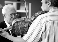 Hand made violins demonstration in Bulgaria royalty free stock images